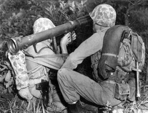 A two man team firing a 3.5 inch rocket launcher.